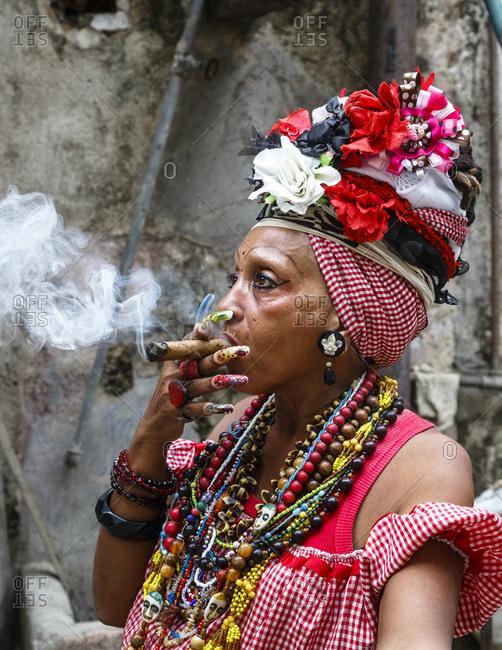 Portrait of a woman smoking cigar, old Havana, Cuba