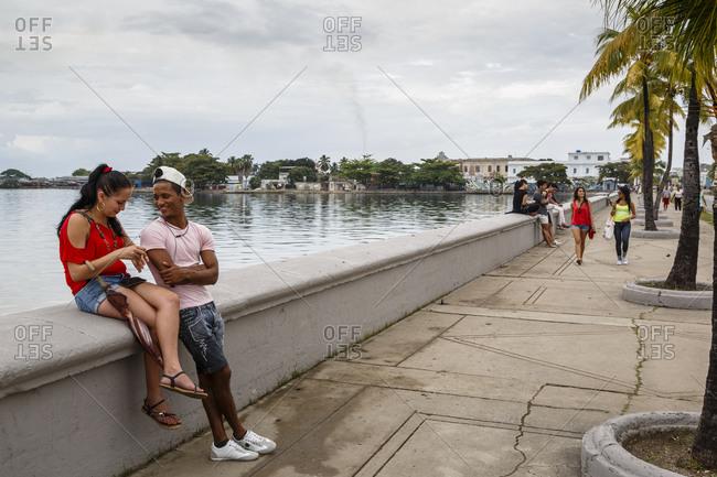 Pinar del Rio, Cuba - January 27, 2016: People at the Malecon waterfront, Cienfuegos, Cuba