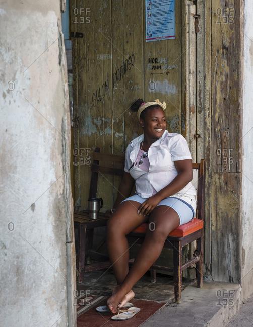 Santiago de Cuba, Cuba - February 3, 2016: Portrait of a young woman, Santiago de Cuba, Cuba