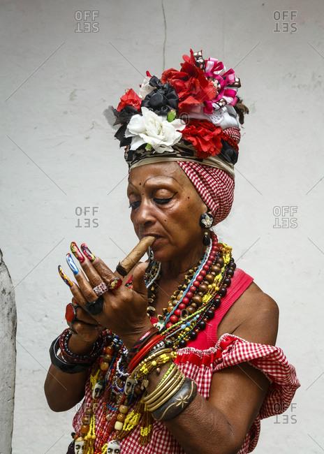 Woman sitting cigar, old Havana, Cuba