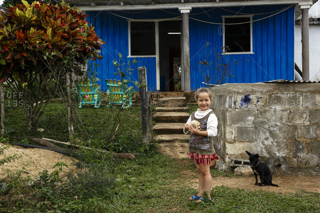 Pinar del Rio, Cuba - January 23, 2016: Portrait of a young girl in front of house at Vi_ales, Cuba