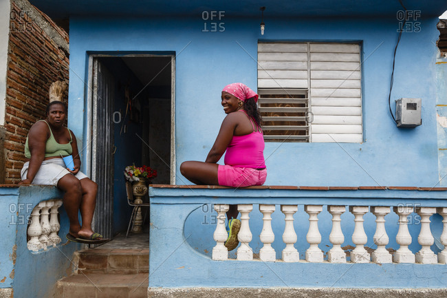 Trinidad, Cuba - January 29, 2016: Women sitting on a balcony, Trinidad, Cuba