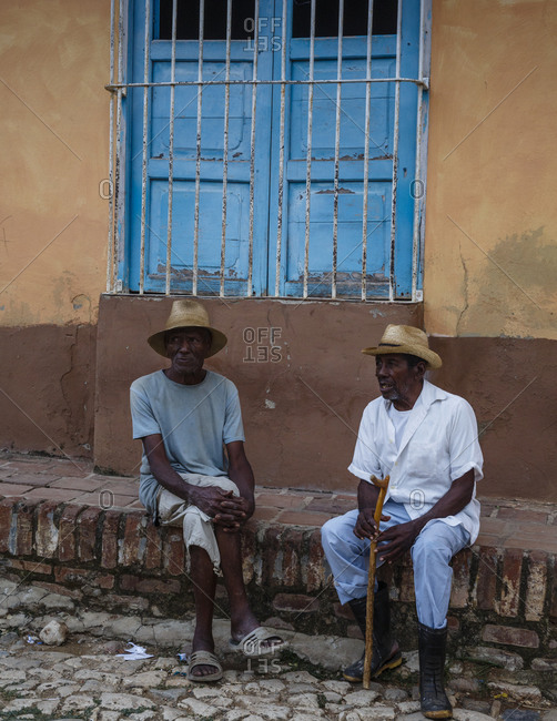 Trinidad, Cuba - January 29, 2016: Elderly men on the street, Trinidad, Cuba
