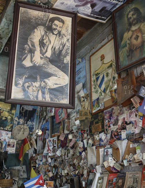 Santiago de Cuba, Cuba - February 2, 2016: Frame picture of Che Guevara hanging at La Escalera bookstore, Santiago de Cuba, Cuba
