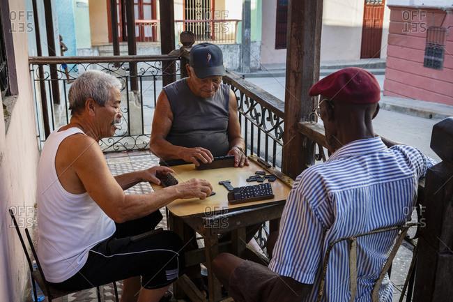Santiago de Cuba, Cuba - February 3, 2016: Men playing domino at the Tivoli neighborhood, Santiago de Cuba, Cuba