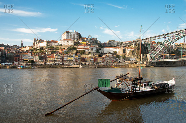 3/3/16: A boat anchored on the Douro River with the Portuguese city of Oporto in the background
