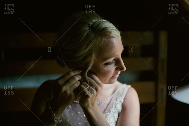 Bride fastening earring to ear
