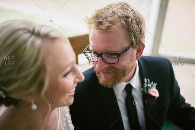 Groom looking at bride admirably