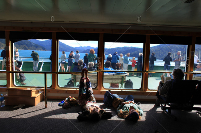 Picton harbor, New Zealand - January 26, 2011: Passengers sleeping on the Interislander ferry from Wellington to Picton Harbor, New Zealand
