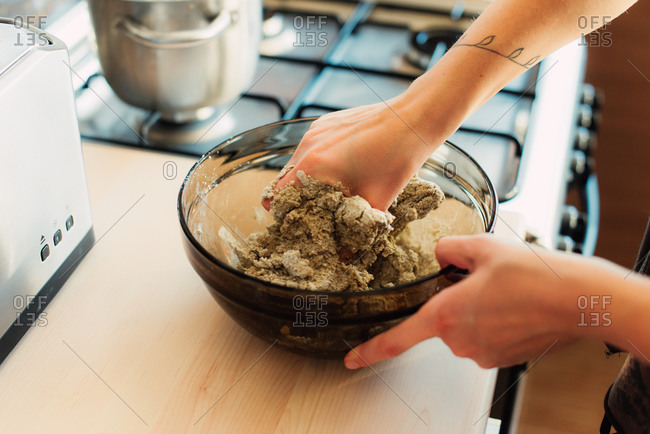 Person mixing dough in a bowl