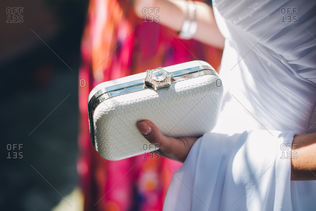 Bride carrying small clutch