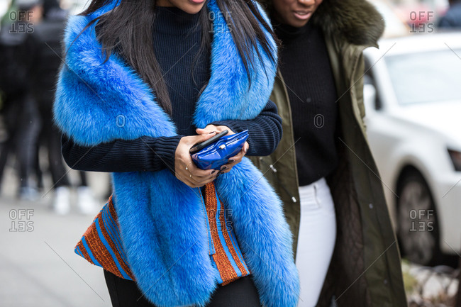 Couple walking down the street wearing fur