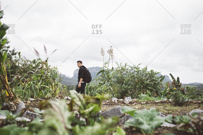 Cuba - January 12, 2016: Man walking on farm