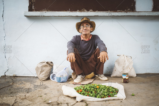 January 12, 2016: Man selling peppers in street