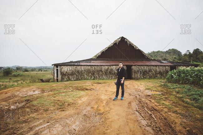 Man standing in tobacco farm