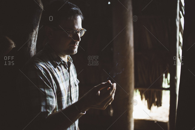 Cuba - January 12, 2016: Man with cigar in a tobacco shed