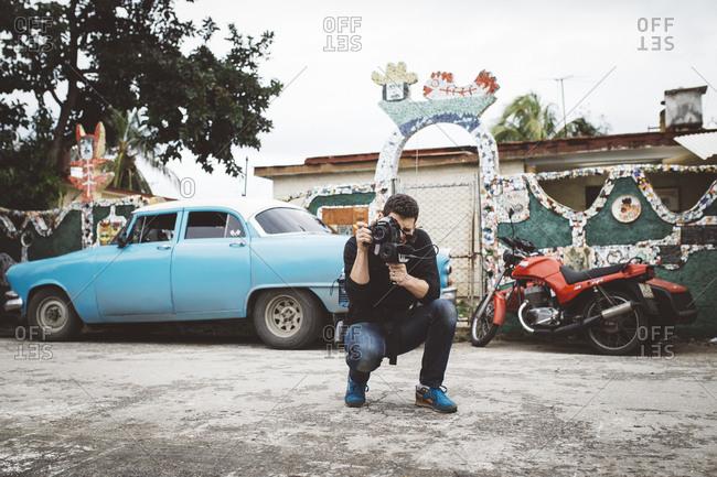 January 13, 2016: Man taking photo on Cuban street