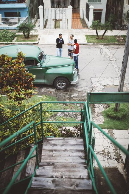 January 13, 2016: Men on Cuban street by car