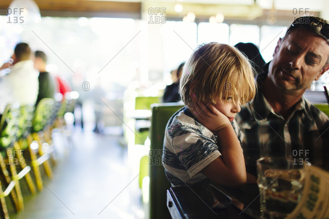 Man sitting with his son in a restaurant