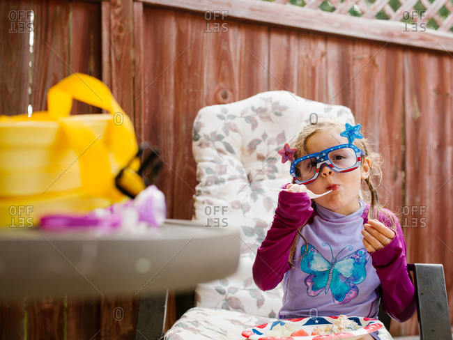 Little girl eating a meal at a Fourth of July Party