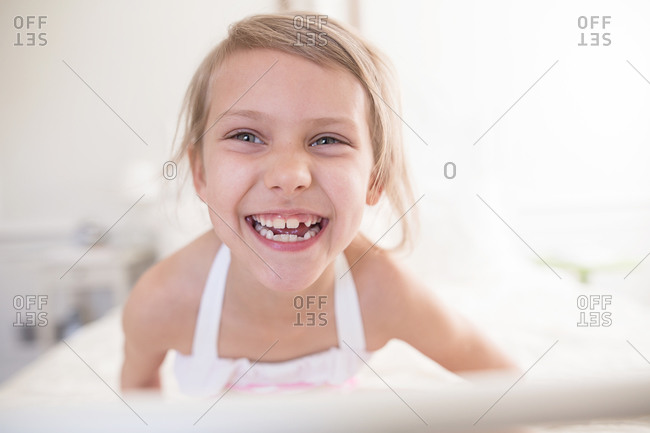 Close-up of a young girl smiling