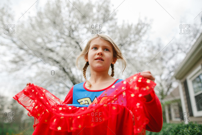 Girl standing outside wearing a costume
