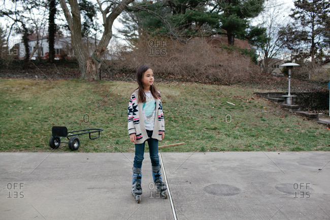 Girl rollerblading at a park