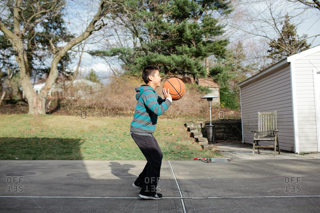 Boy getting ready to shoot a basketball