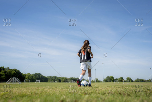 Low angle view of girl on soccer field