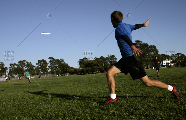 Man playing with a flying disc