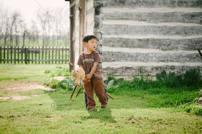 Little boy playing with hobby horse