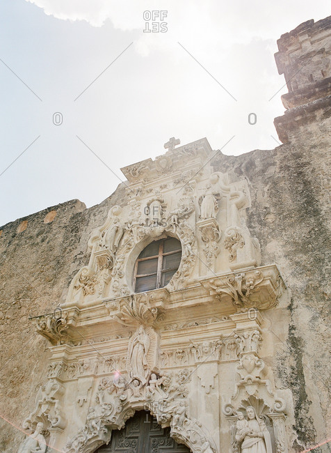 Carved limestone figures adorn the exterior of Mission San Jose, Texas