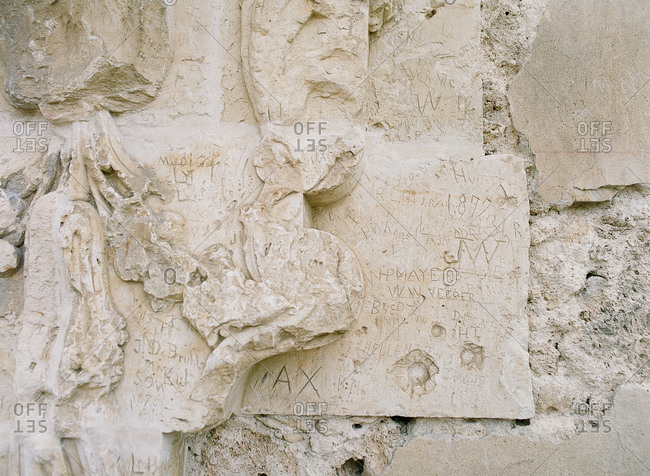 Graffiti from 1877 carved in the limestone at Mission San Jose, Texas
