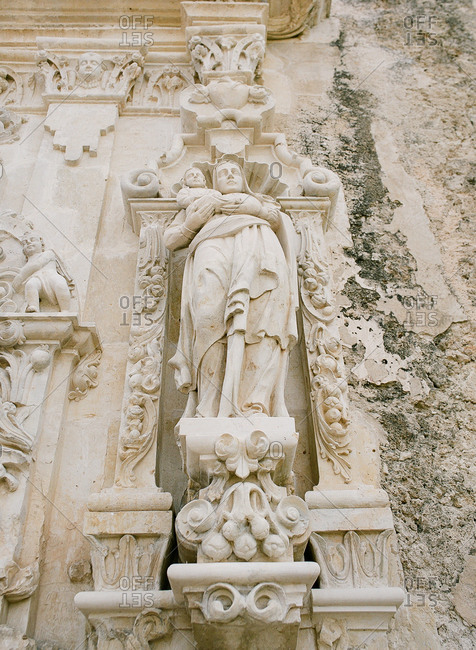Limestone statue of St. Anne holding the infant Mary at Mission San Jose