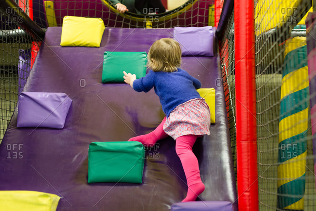 Young girl climbing in play area