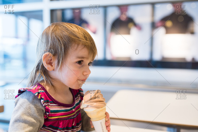 Girl staring with ice cream cone