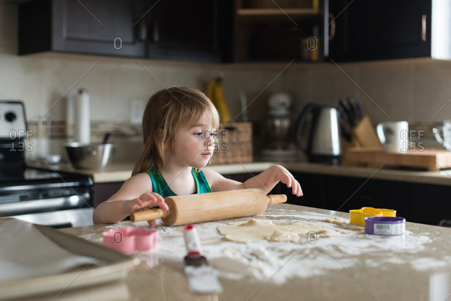 Girl rolling out dough