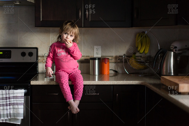 Girl in pajamas on counter