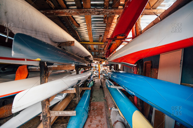 Several sprint canoes on a rack