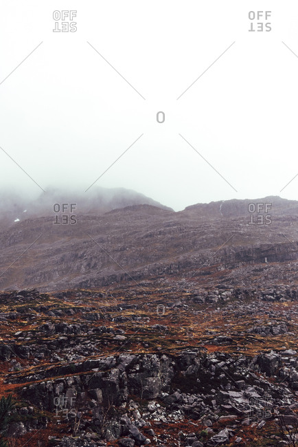 Rugged mountain covered in fog
