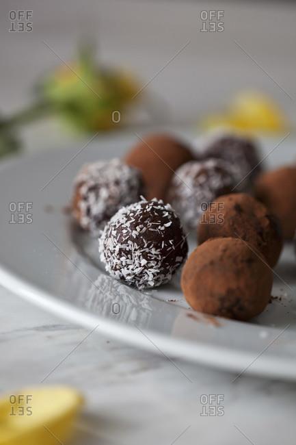 Vegan chocolate almond date balls on a ceramic plate