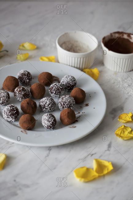 Vegan chocolate almond date balls on a white plate