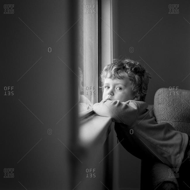 Boy leaning on a window