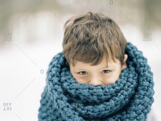 Boy in big scarf