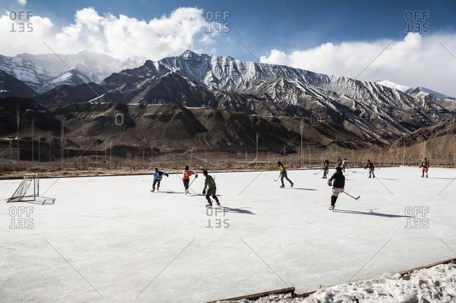Children playing hockey in India