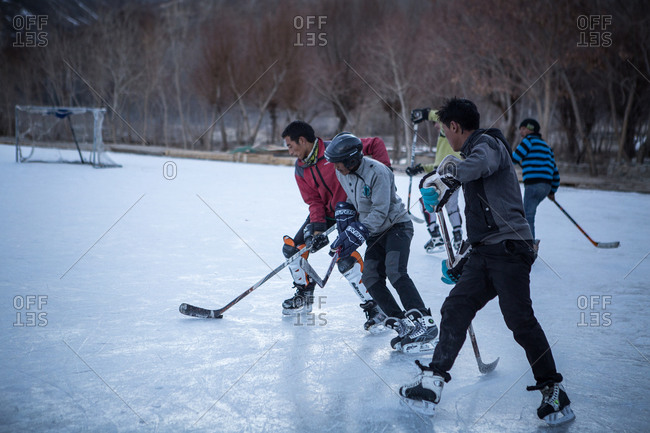 Leh, India - February 10, 2015: Kids playing hockey