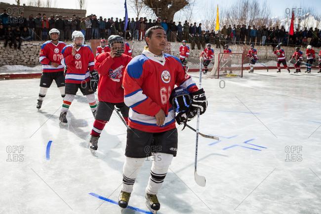 Ladakh, India - February 13, 2015: Hockey players entering rink