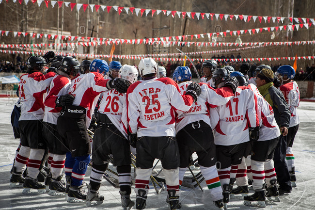 Ladakh, India - February 13, 2015: Hockey team in huddle