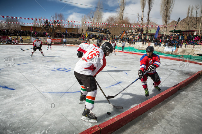 Ladakh, India - February 13, 2015: Hockey teams playing