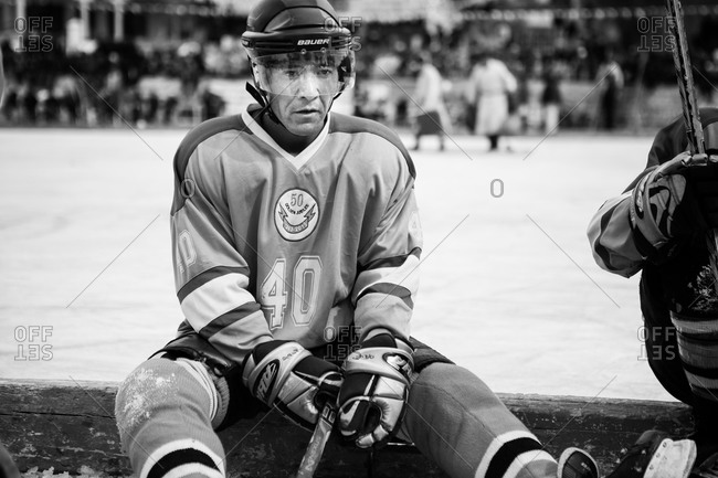 Ladakh, India - February 13, 2015: Hockey player sitting